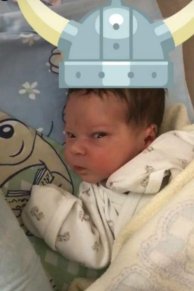 Антон восхищается новорожденным сыном