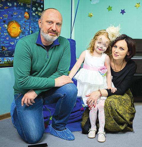 Александр и Елена с общей дочерью Соней