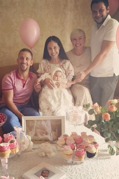 Счастливые родители и крестные Дианы