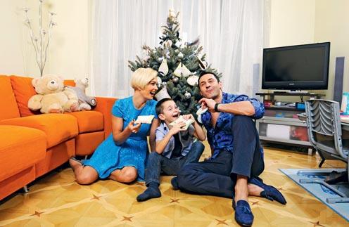 Стас Костюшкин с женой Юлей и сыном Богданом