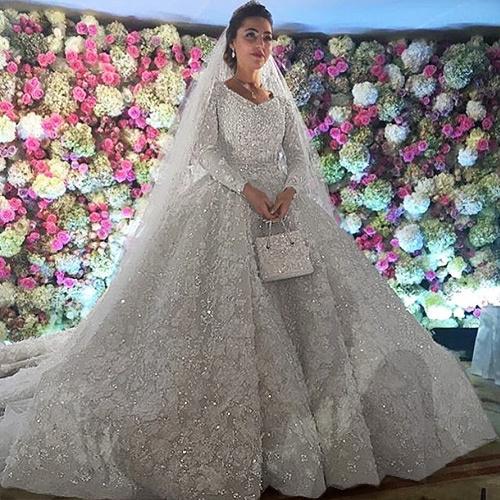 Платье невесты от модного дома Ellie Saab весит 25 килограммов
