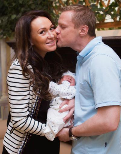 Екатерина и Вячеслав Малафеевы с новорожденным сыном