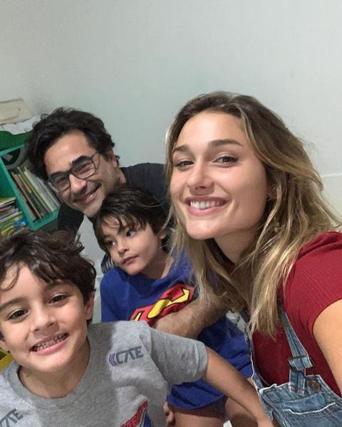 Лусиано с дочерью и сыновьями