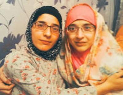 Умерла одна из сиамских близнецов Зита Резаханова